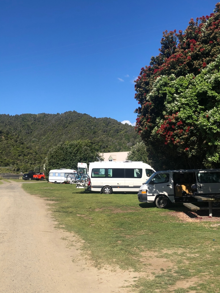 The Kiwi Blog Bus Campervan parked in a freedom camping spot near the Three Sisters